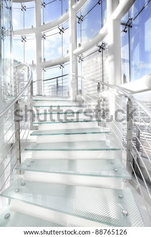 modern spiral glass stairs in a glass building - stock photo