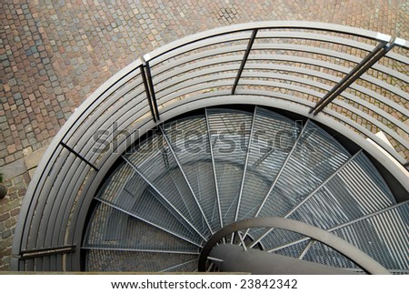 modern spiral steel stairs in urban environment - stock photo