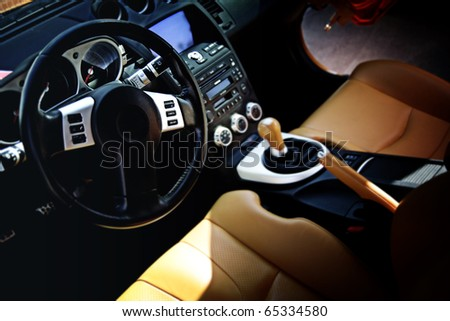 Modern sport car interior: brown wood and leather - stock photo