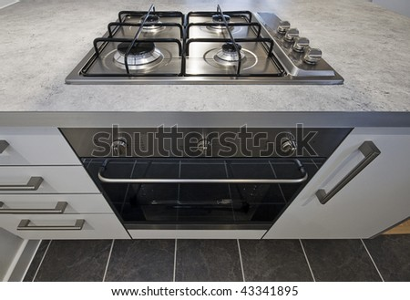 modern stainless steel electric oven and gas hob - stock photo