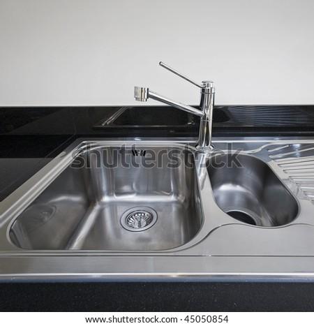modern stainless steel kitchen sink detail shot - stock photo