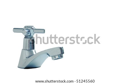 Modern stainless steel tap - stock photo