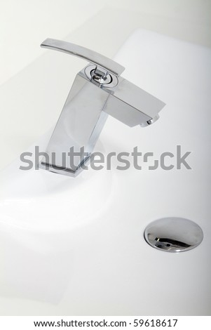 modern stainless tap - stock photo