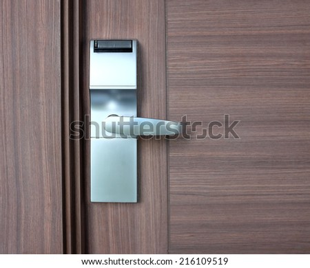 modern stainless with card insert handle on wood door - stock photo