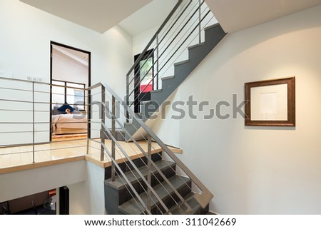 Modern staircase in private home with art-frame for copy space.  - stock photo