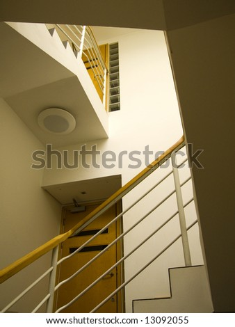 modern stairwell with white walls and hand rail