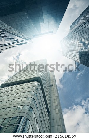 modern steel and glass office skyscrapers view from sea level, Frankfurt am Main, Germany - stock photo