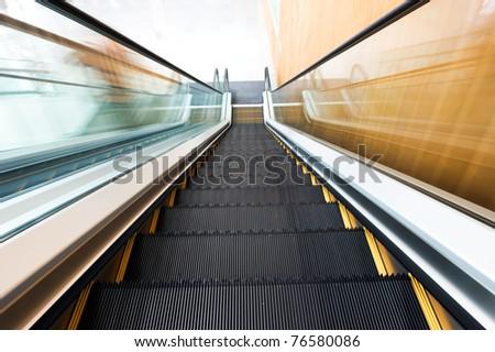 modern steps of moving business escalator - stock photo