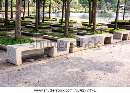 Modern stone Bench In the garden beside the road,Concrete bench,Cement bench - stock photo