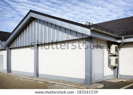 modern store front and parking lots - stock photo