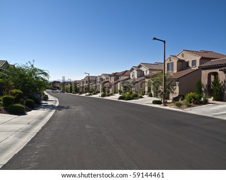 Modern street of typical middle class desert homes near Las Vegas Nevada. - stock photo