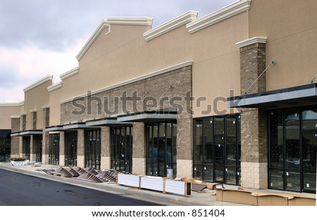 Modern Strip Shopping Center Construction - stock photo
