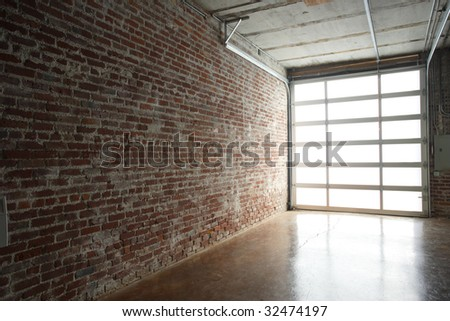 Modern studio loft with garage door - stock photo