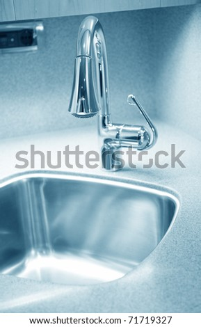 Modern style chrome bathroom tap in modern bathroom. - stock photo
