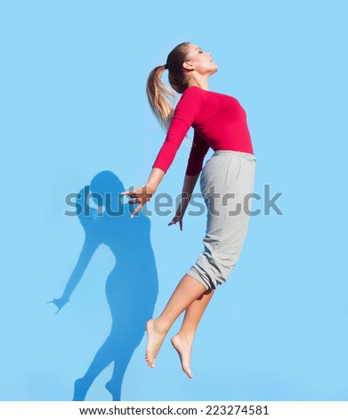 Modern style dance woman performing and  jumping up - stock photo