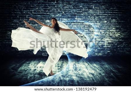 modern style dancer on dirty grunge background - stock photo