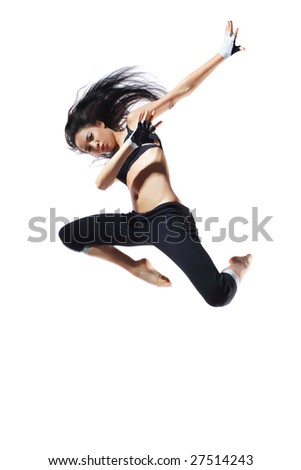 modern style dancer posing behind studio background - stock photo