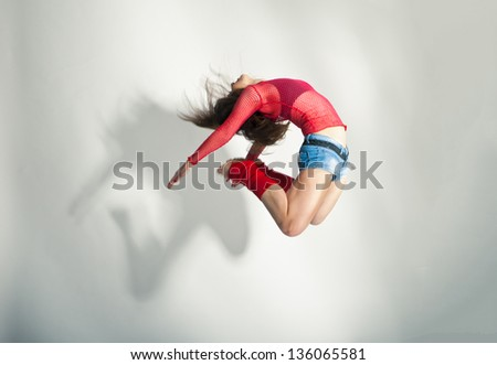 Modern style dancer posing on a studio white background - stock photo
