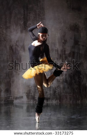 modern style dancer posing on dirty grunge background - stock photo
