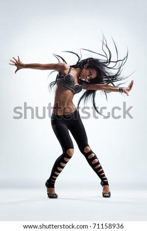 modern style dancer posing on studio background - stock photo