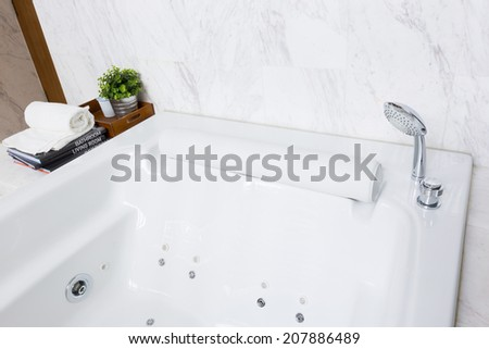 Modern style luxurious jacuzzi bathtub with white marble wall
