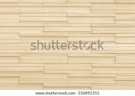 Modern style marble tile wall rough textured detailed patterned backdrop for interior decoration: Marble tiled wall linear pattern texture background in light yellow cream beige brown color tone - stock photo