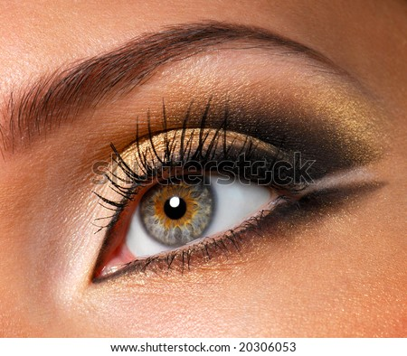 Modern style of golden-brown make-up. Beautiful woman eyes - stock photo