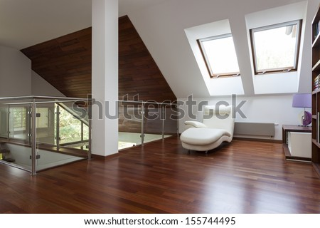 Modern stylish attic, mezzanine with place for relaxing - stock photo