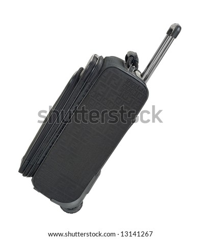 Modern stylish black travel suitcase with pullout handle tilted side view isolated on white - stock photo