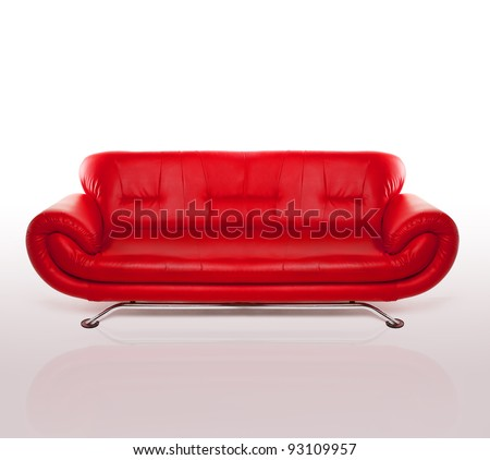 Modern stylish couch with arms and a metal frame upholstered in red leather, studio over white - stock photo