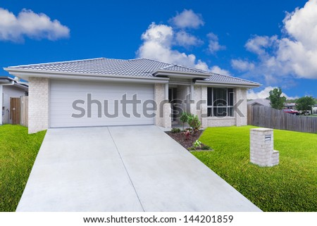 Modern suburban house on sunny day - stock photo