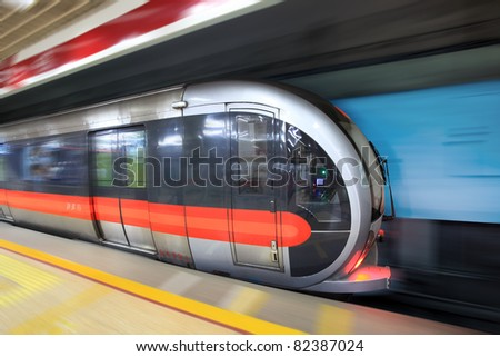 modern subway train with motion blur in beijing,China - stock photo