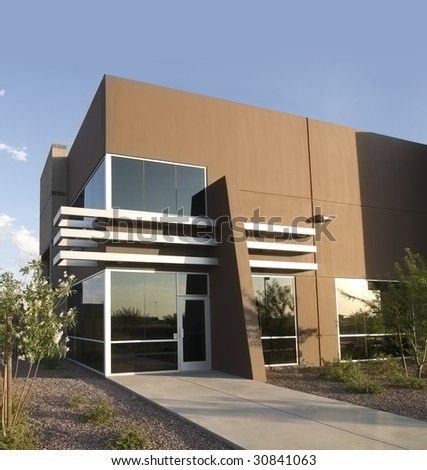 Modern successful business exterior of medium sized company - stock photo