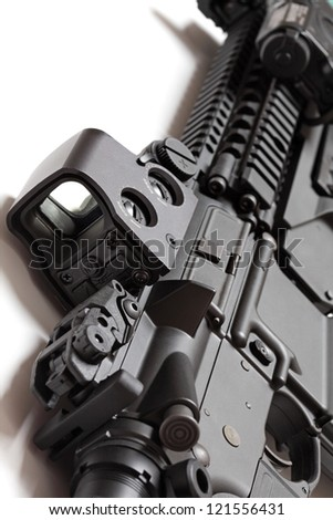 Modern tactical laser sght on an assault carbine close-up. Modern weapon series. - stock photo
