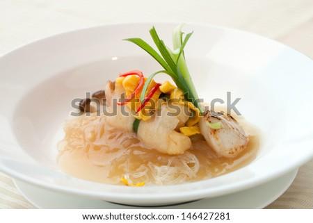 Modern take on seafood noodles - stock photo