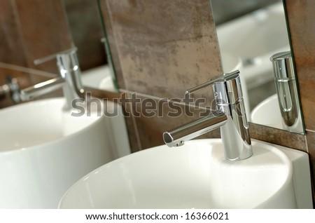 Modern tap in bathroom showroom. - stock photo