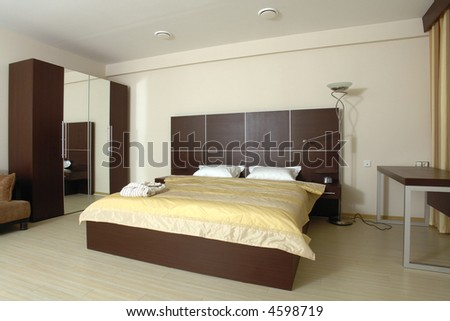 Modern tastefully and simply  decorated bedroom