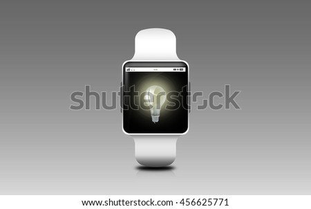 modern technology, idea, object and media concept - illustration of black smart watch with light bulb icon on screen over gray background - stock photo