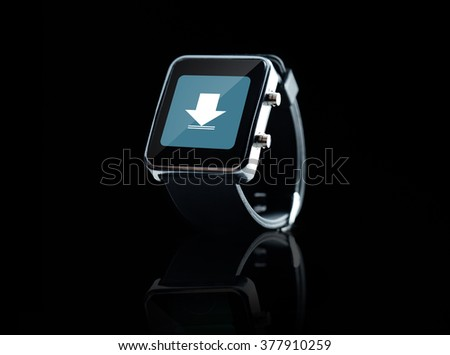 modern technology, object and media concept - close up of black smart watch with download icon on screen - stock photo