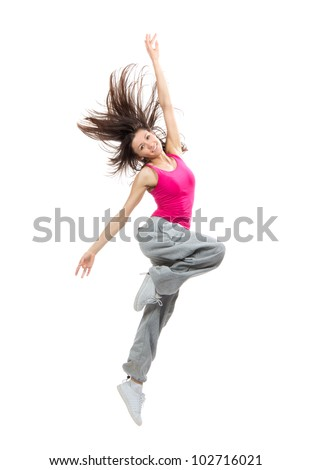 Modern teenage girl dancer dancing hip-hop and jumping with windy hair smiling isolated on a white background - stock photo