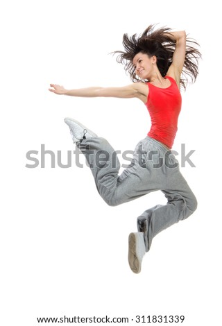 Modern teenage girl dancer jumping and dancing hip-hop in red tshirt isolated on a white background