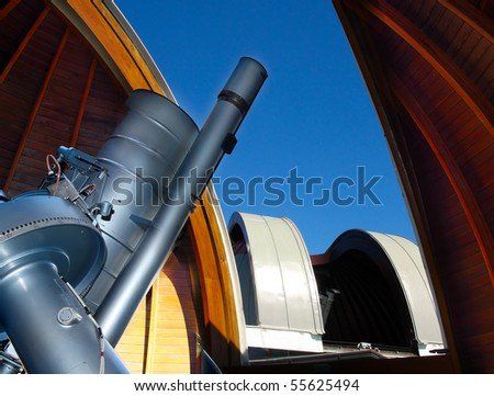 Modern telescope in astronomic observatory. - stock photo