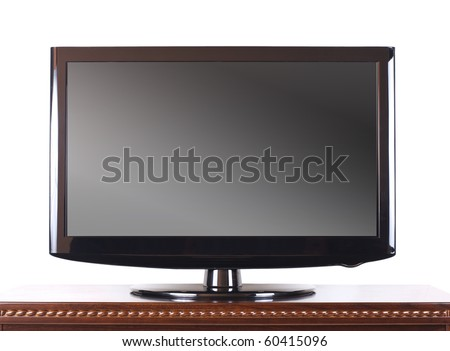 Modern television on wooden cabinet in the living room - stock photo
