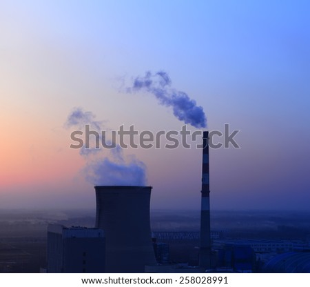 Modern thermal power plant under the setting sun  - stock photo