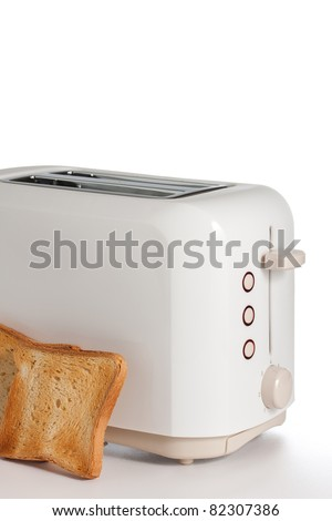 Modern toaster with bread slices - stock photo