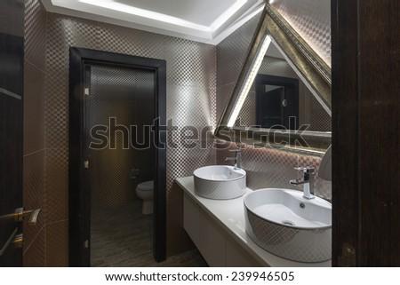 Modern toilet interior - stock photo