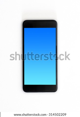 Modern touch screen smartphone and blue screen isolated on white paper texture with clipping path. - stock photo