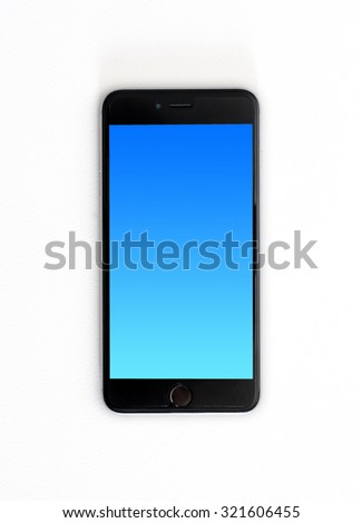 Modern touch screen smartphone and blue screen isolated on white paper texture with clipping path.