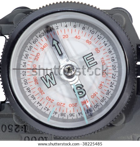 Modern tourist compass in the metal case