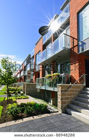 Modern town houses of brick and glass on urban street - stock photo